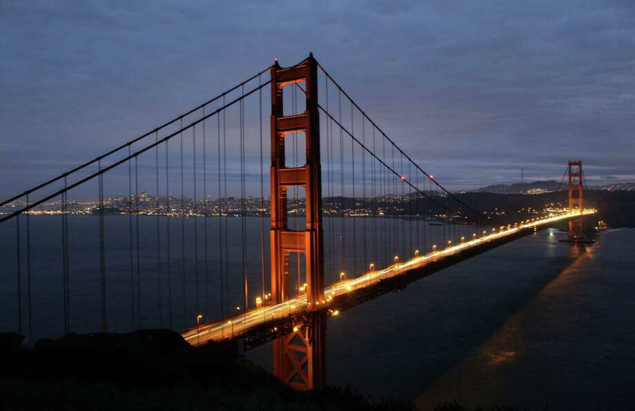 """Bay Area landmark: Golden Gate Gate Bridge and Bay BridgeOpened just six months apart, they connect San Francisco not just to the rest of the Bay Area, but also the world. Designed by Charles H. Purcell and with 152,000 tons of steel, the Bay Bridge came first in 1936 with great fanfare – President Franklin Roosevelt called it the largest construction project in US history. A million people were there for the opening-day festivities.The Golden Gate Bridge upstaged its slightly older sister right away in 1937 with a six-day party and the Chronicle headline, """"A Steel Knife Unsheathed By the City Splits the Sky."""" The Golden Gate stood out from its fellow suspension bridge with its higher towers (746 feet to 526), lower roadway, and fiery International Orange color, as imagined by architect Irving Morrow. Photo: Eric Risberg, AP / AP2012"""