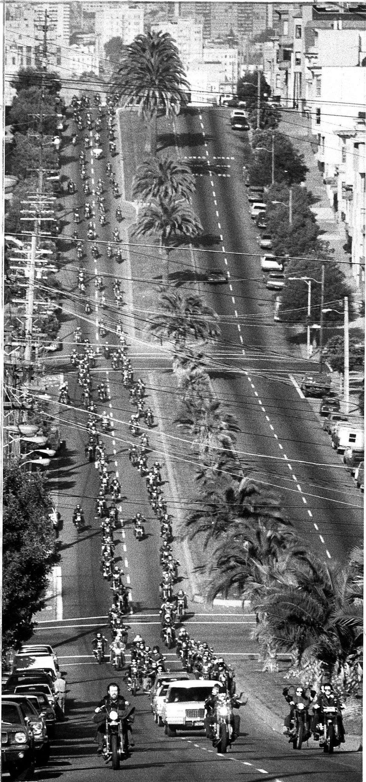 Hells Angels and members of other motorcycle clubs form a funeral cortege aloong Dolores Street for Harry the Horse Flamburis, January 14, 1977 Photo ran 01/15/1977 P. 2