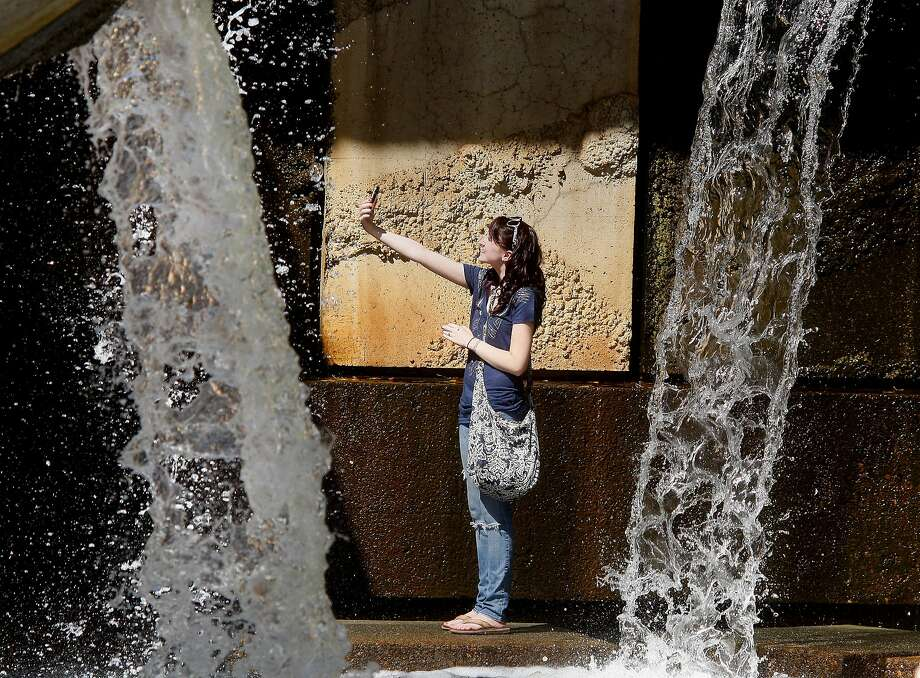 Ellie Koning of Newark, Calif., stopped to take her own picture inside the Vaillancourt fountain at Justin Herman Plaza Monday, September 19, 2011. Photo: Brant Ward, The Chronicle