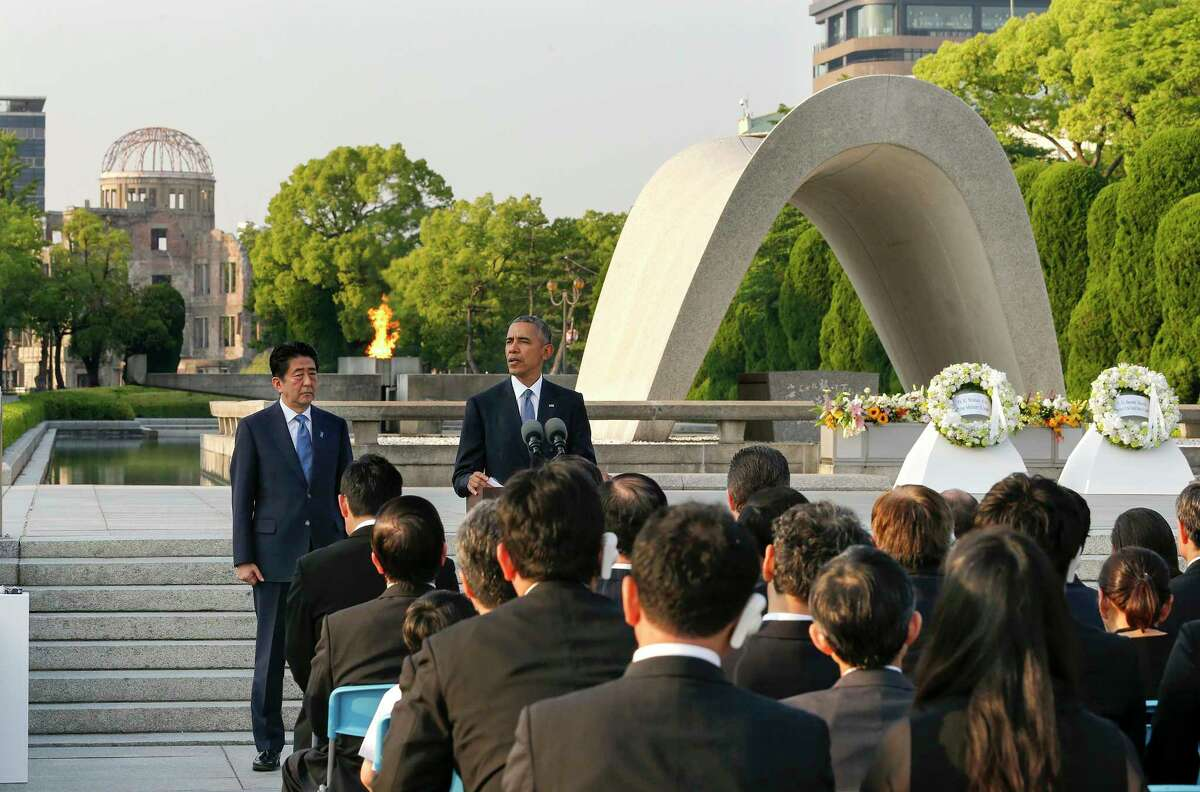 U.S. President Barack Obama gives a speech next to Japanese Prime Minister Shinzo Abe at Hiroshima Peace Memorial Park in Hiroshima, western, Japan, Friday, May 27, 2016. Obama on Friday became the first sitting U.S. president to visit the site of the world's first atomic bomb attack, bringing global attention both to survivors and to his unfulfilled vision of a world without nuclear weapons. The Atomic Bomb Dome is seen in the background.