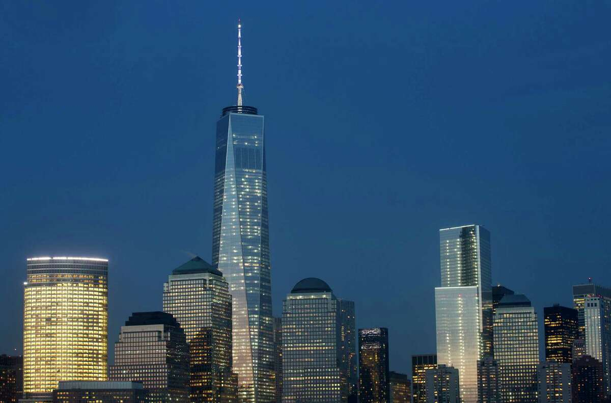 """Goldman Sachs headquarters, left, One World Trade Center, second left, and 4 World Trade Center, center, stand above the lower Manhattan skyline, Wednesday, April 2, 2014 in New York. About 700 people will race up 72 floors at 4 World Trade Center, Thursday in an event called the """"Runyon Up,"""" organized by the Damon Runyon Cancer Research Foundation."""