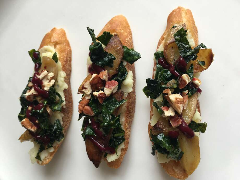 Crostini topped with ingredient pairings, fingerling potatoes, kale, roasted pecans and blackberry juice, suggested by IBM's Chef Watson. Photo: Sarah Fritsche