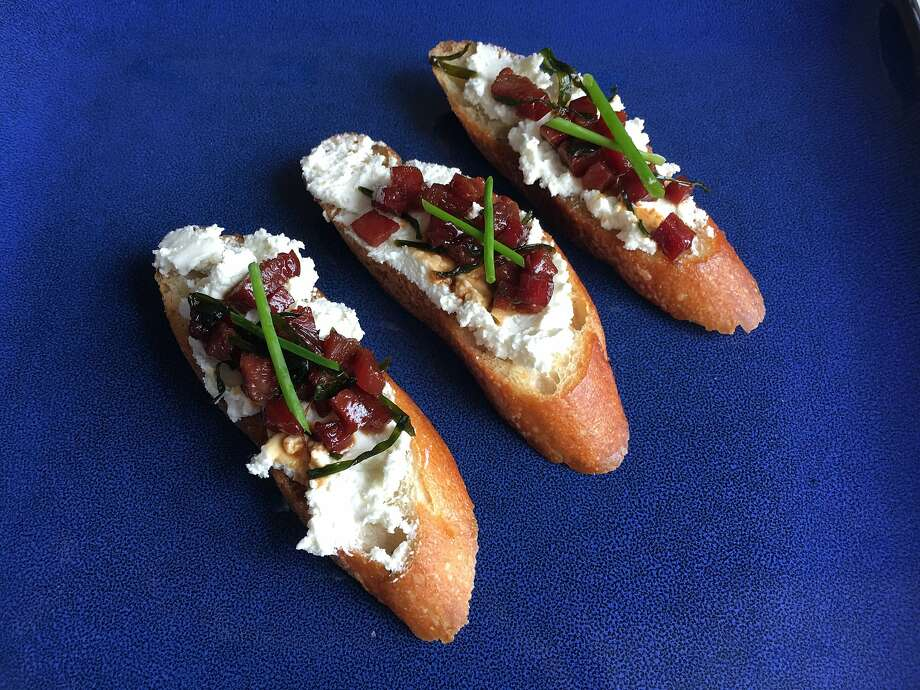 This crostini topping, made from Chef Watson's suggested pairings of goat cheese, ham, soy sauce and chives, got mixed reviews from tasters. Photo: Sarah Fritsche