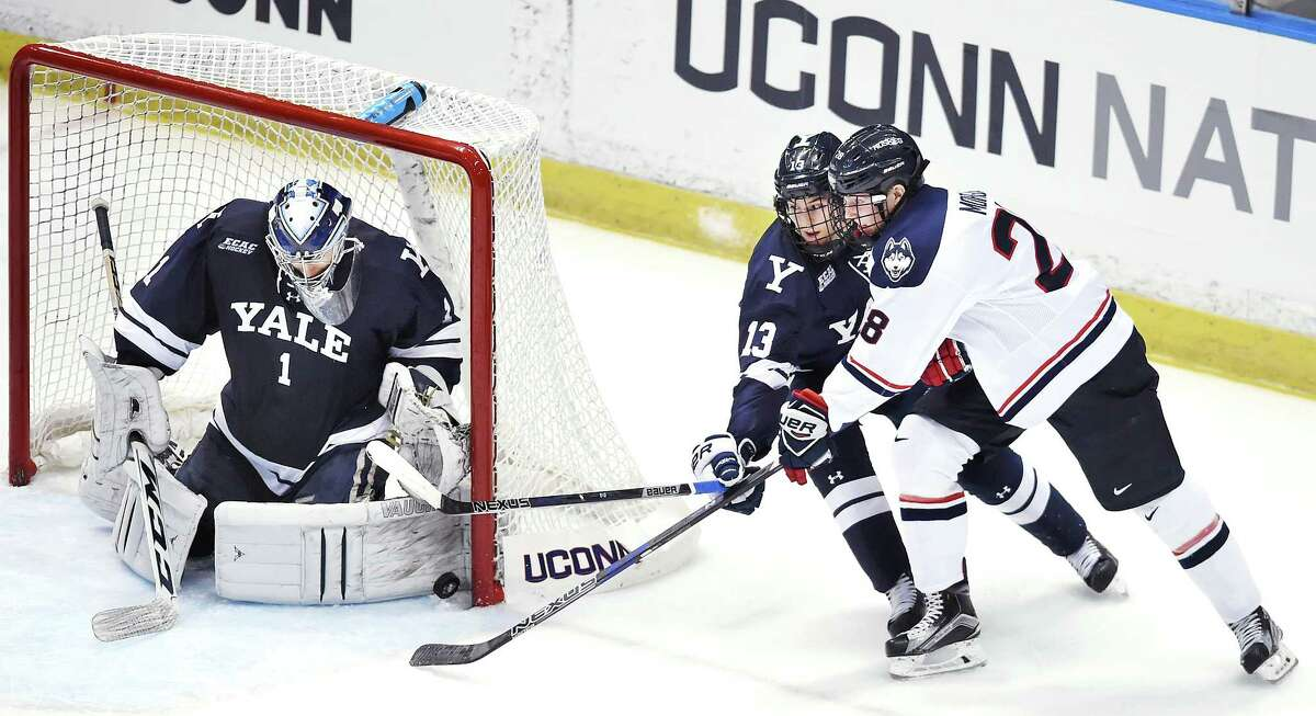 Yale goalie Sam Tucker and forward Evan Smith deny UCONN forward Brian Morgan a chance to score a second goal for the Huskies, as the Bulldogs win 4-2, at the XL Center in Hartford, in front of an impressive crowd of 4,909, during the nor'easter, Saturday, January 7, 2017. (Catherine Avalone/New Haven Register)