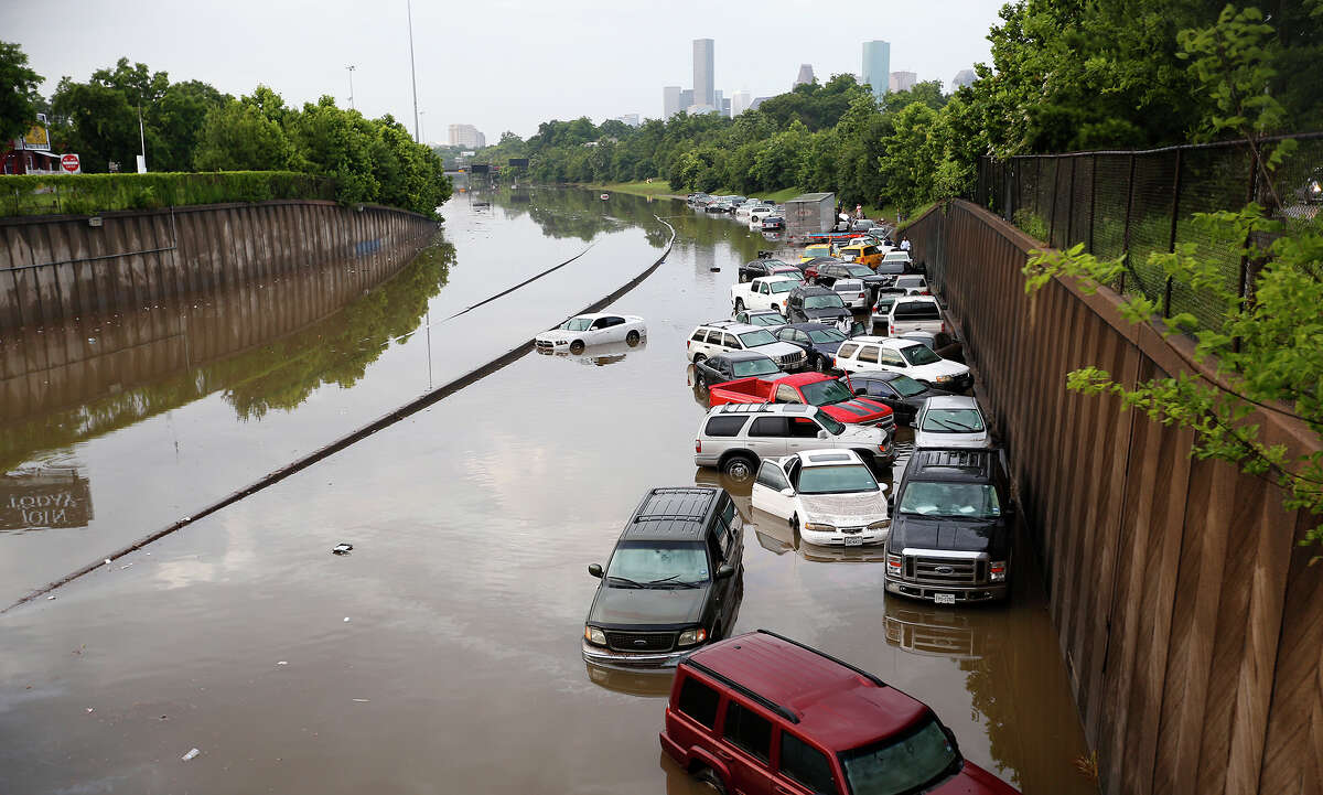 Motorists are stranded along I-45 along North Main in Houston after storms flooded the area, Tuesday, May 26, 2015. Overnight heavy rains caused flooding closing some portions of major highways in the Houston area.
