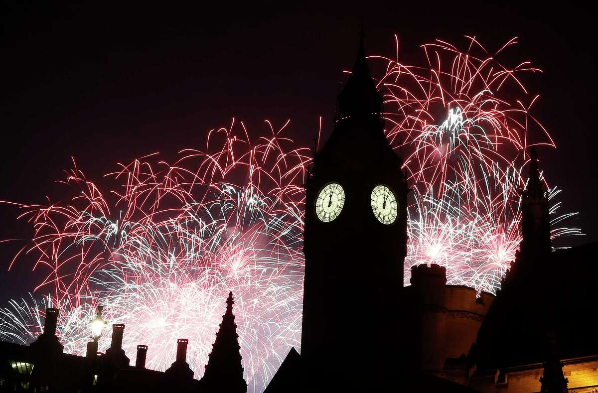 United Kingdom London rings in the new year by chiming Big Ben at midnight for more than 100,000 revelers who gather around the River Thames. A massive fireworks display and partying in the streets follows.