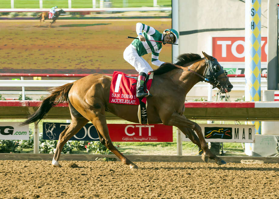 Accelerate and jockey Victor Espinoza win the Grade II, $300,000 TVG San Diego Handicap race Saturday at Del Mar Thoroughbred Club in Del Mar. Photo: Benoit Photo Via AP   / © BENOIT PHOTO