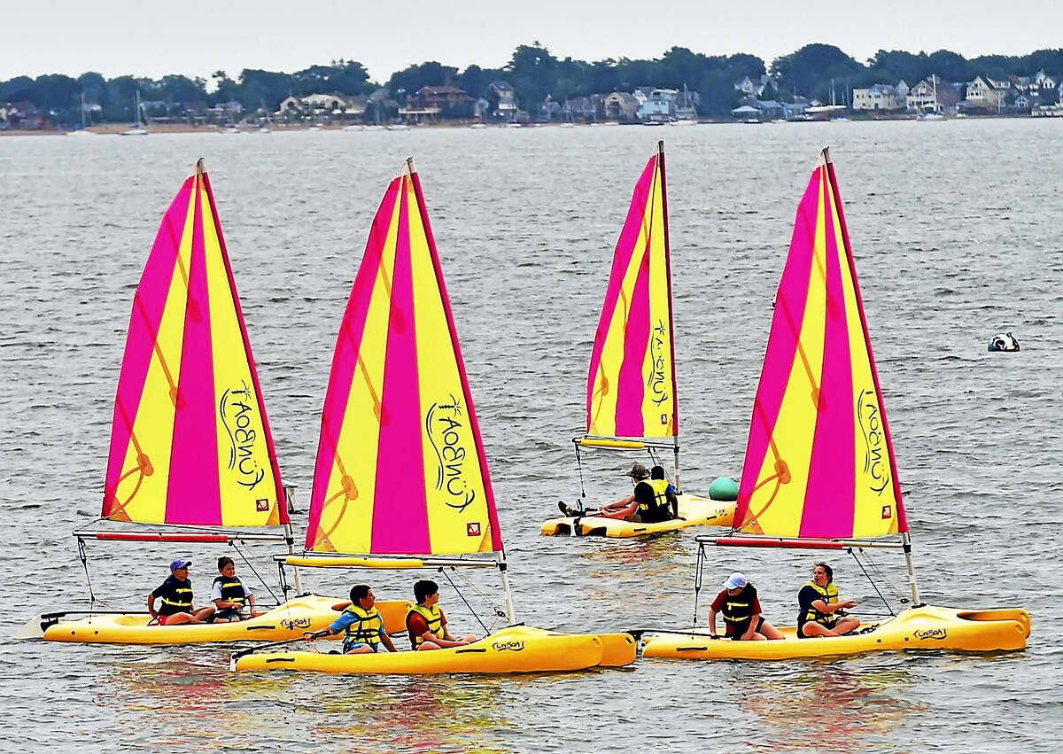 The New Haven Land Trust Schooner Camp campers learn how to sail Thursday at the Sound School facilities in New Haven.