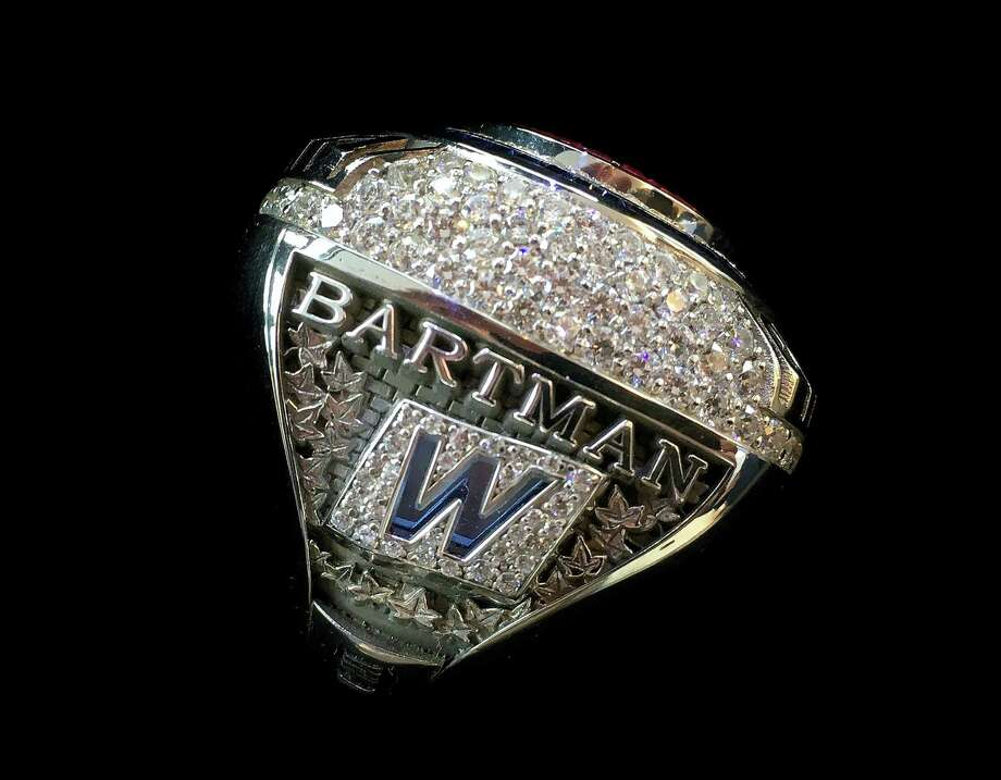 This photo provided by the Chicago Cubs shows a 2016 World Series championship ring the team was giving to Steve Bartman, the fan remembered for deflecting a foul ball that appeared destined to land in left fielder Moises Alou's glove with Chicago five outs from the World Series in 2003. Photo: Chicago Cubs Via AP   / Chicago Cubs
