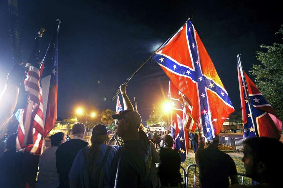 Gerald Herbert / associated press   Demonstrators who supports keeping Confederate era monuments protest before the Jefferson Davis statue was taken down in New Orleans. Photo: AP / Copyright 2017 The Associated Press. All rights reserved.