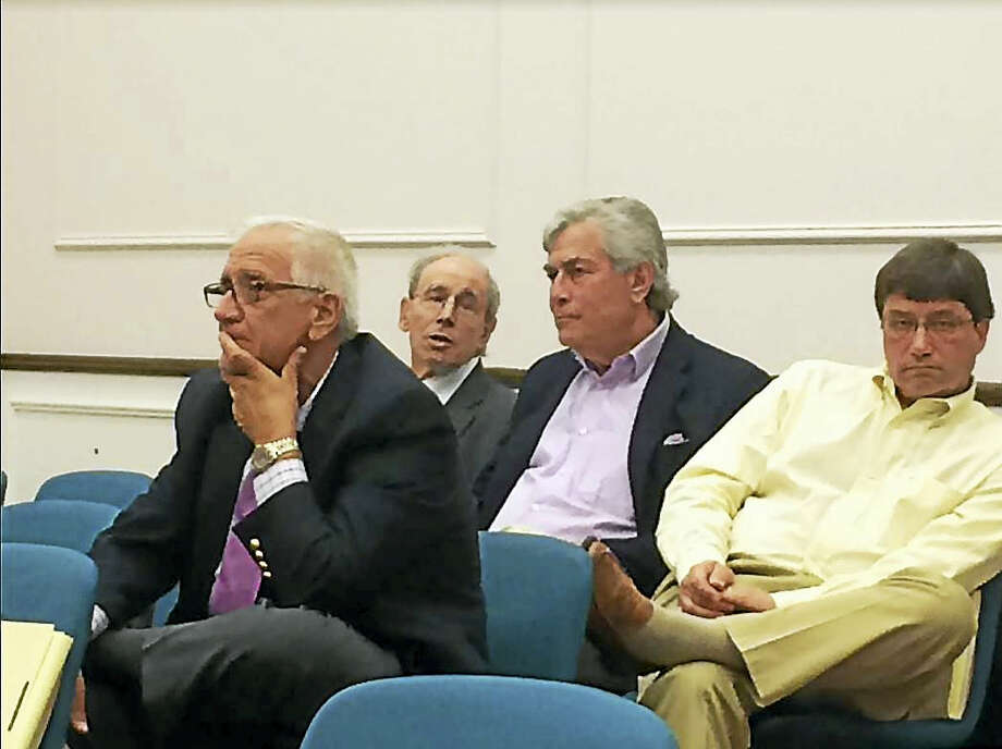 Developer David Beckerman of the Acorn Group, second from right, listens to the West Haven City Council discuss a proposal to sell his company 9,024 square feet of the Louis Piantino Allingtown Branch Library's parking lot Monday night. Also in the photo are, from left, West Haven Commissioner of Planning and Development Joseph Riccio Jr., attorney Mark Sklarz and Acorn Group Vice President Gary Letendre. Photo: Mark Zaretsky / Hearst Connecticut Media