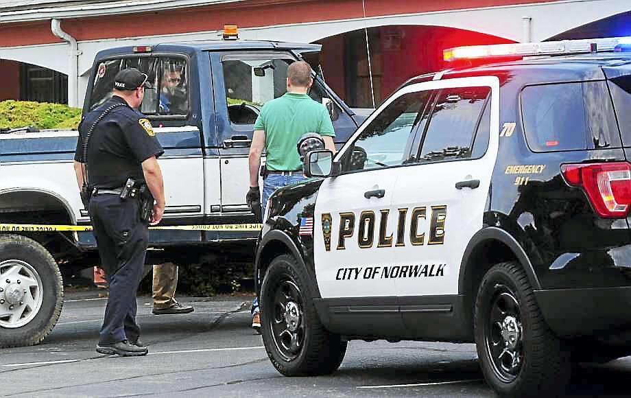 Norwalk police respond to a reported drug overdose Saturday at the Garden Park Motel on Westport Avenue in Norwalk. Photo: Erik Trautmann / Hearst Connecticut Media
