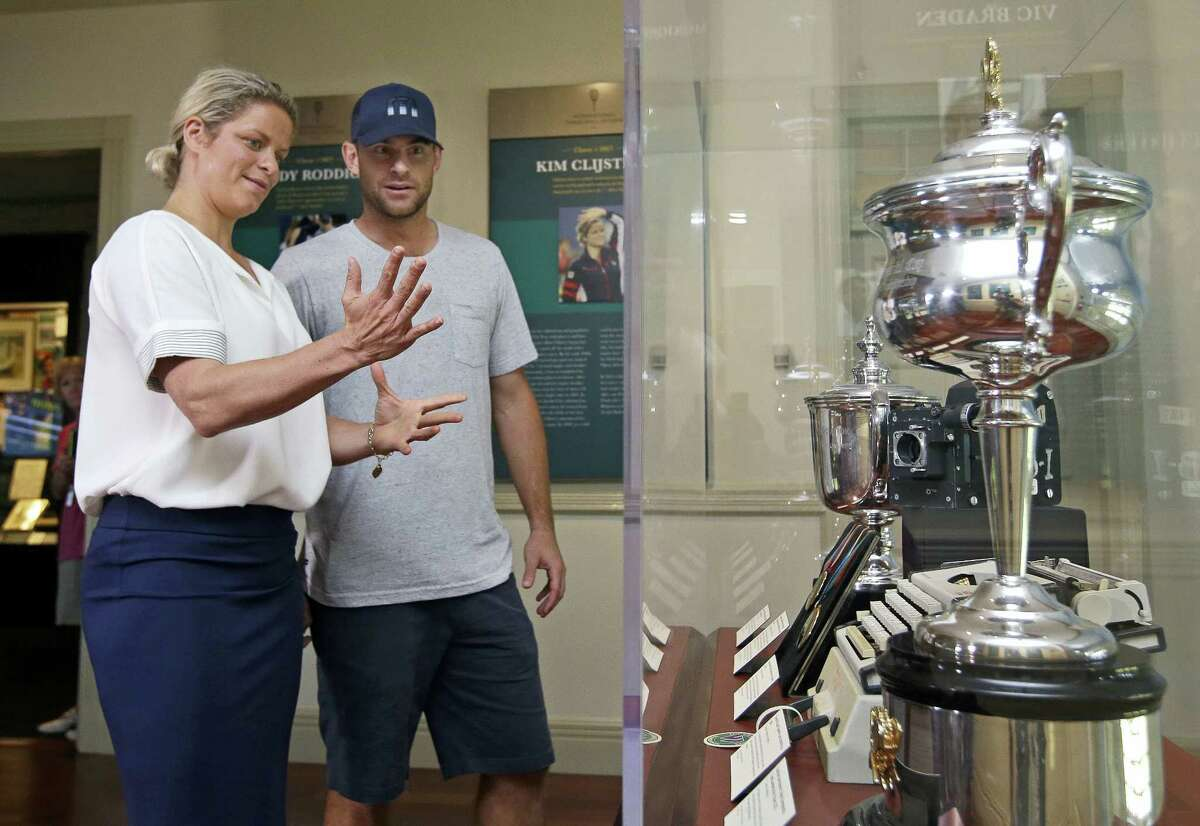 Tennis stars Kim Clijsters and Andy Roddick chat about their trophies displayed at the International Hall of Fame Tennis Museum, Friday in Newport, R.I.