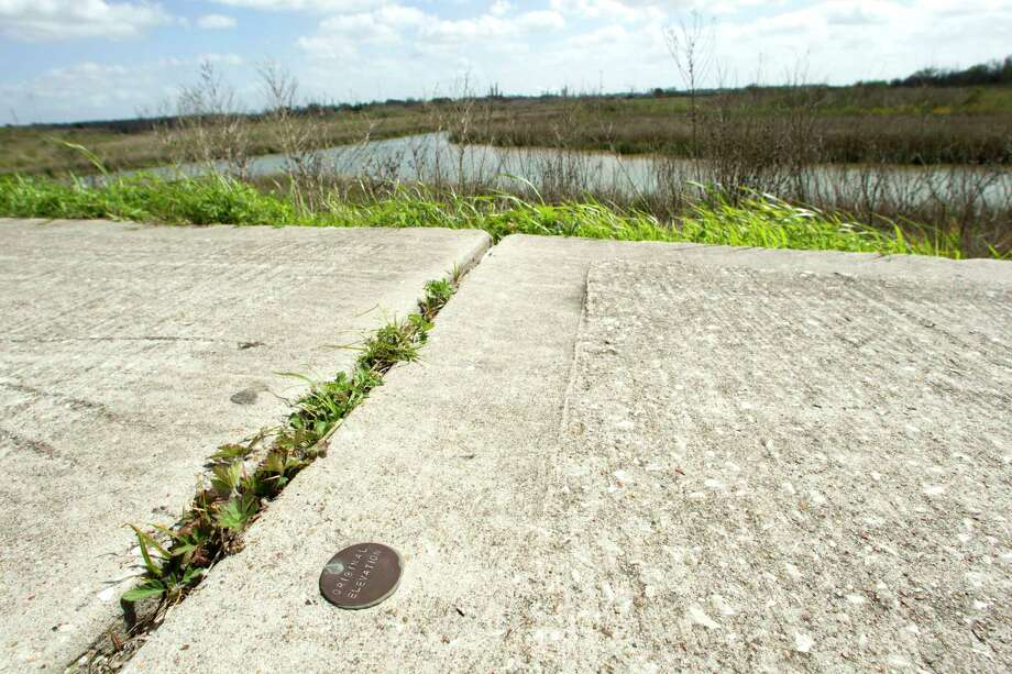 A medallion marking the original elevation of the Brownwood subdivision is seen at the Baytown Nature Center  in Baytown. During the 1940s and 50s, Brownwood was a prosperous suburb, with hundreds of houses, near Baytown. ( Brett Coomer / Houston Chronicle ) Photo: Brett Coomer, Staff / © 2013 Houston Chronicle