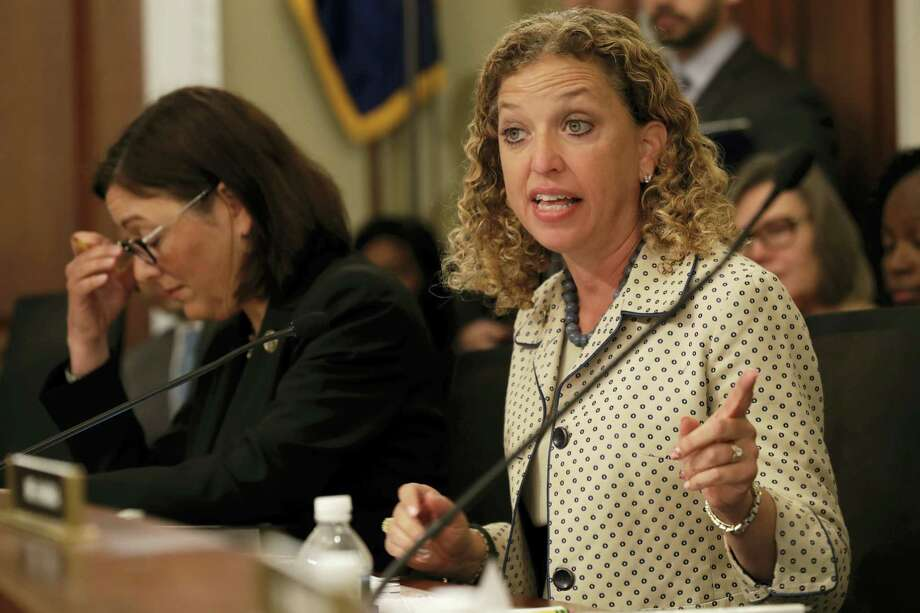In this May 24, 2017, file photo, House Budget Committee member Rep. Debbie Wasserman Schultz, D-Fla. questions Budget Director Mick Mulvaney on Capitol Hill in Washington during the committee's hearing on President Donald Trump's fiscal 2018 federal budget. Fellow committee member Rep. Susan DelBene, D-Wash. is at left. Wasserman Schultz fired IT staffer Irman Awan on July 25, 2017, following his arrest on a federal bank fraud charge. (AP Photo/Jacquelyn Martin, File) Photo: AP Photo/Jacquelyn Martin, File    / Copyright 2017 The Associated Press. All rights reserved.