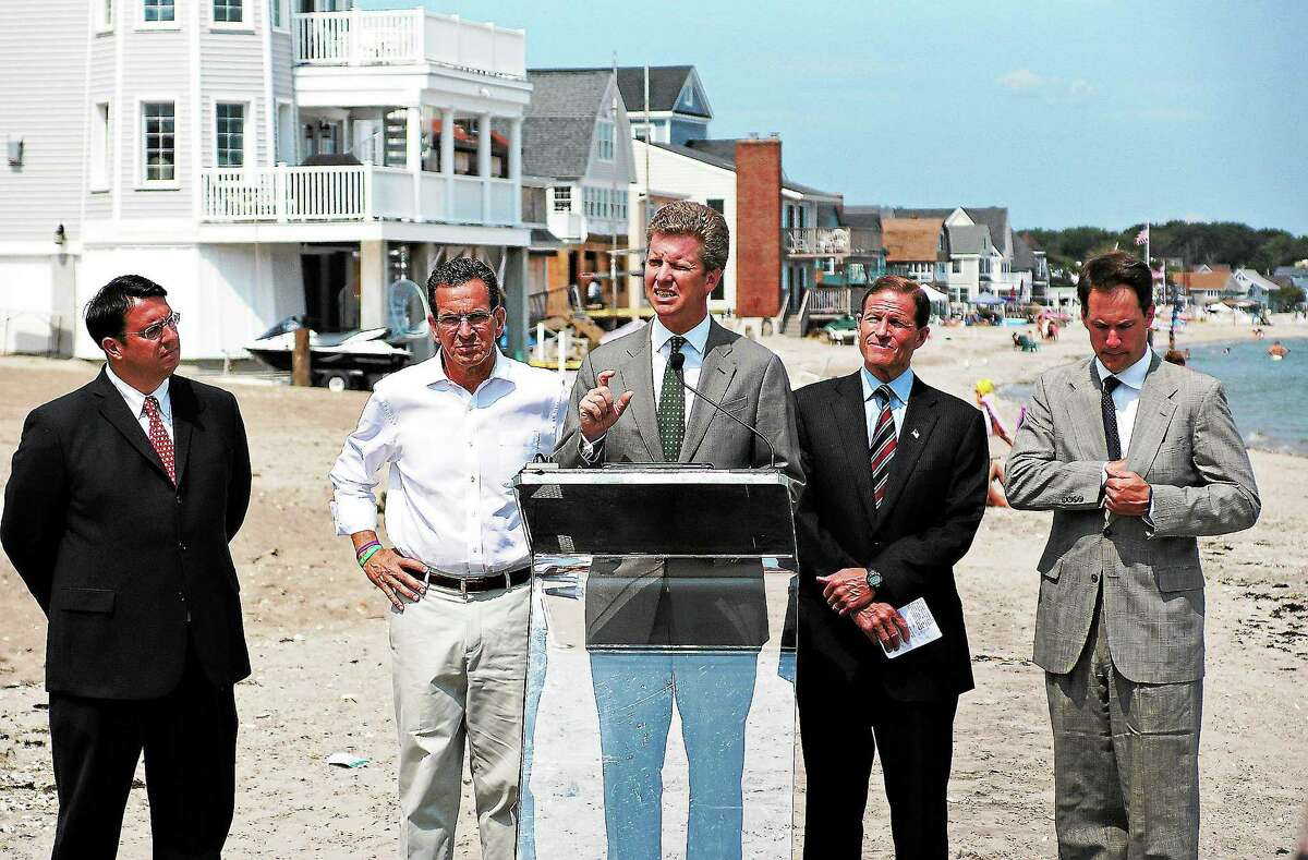 Then-HUD Secretary Shaun Donovan speaks during a 2013 press conference on the beach. Behind him, right to left is; U.S. Rep. Jim Hines, Sen. Richard Blumenthal, Gov. Dannel P. Malloy and Milford Mayor Ben Blake.