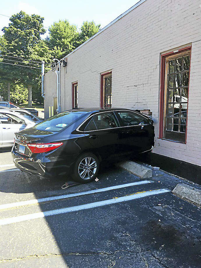 A car crashed into a salon in Milford on Wednesday morning. Photo: Courtesy Of Milford Police