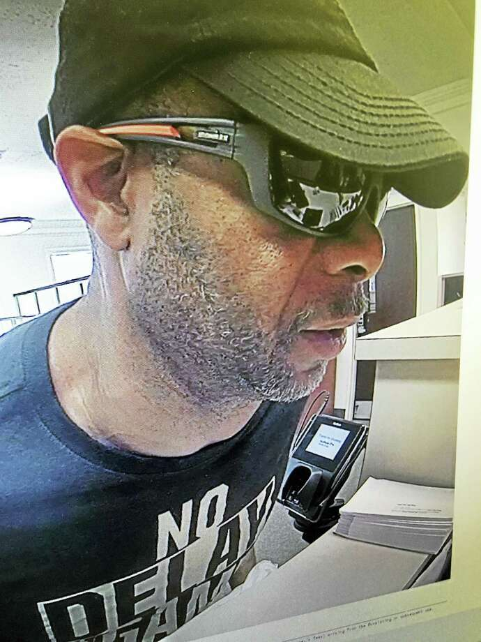 Police are looking for a tall black male suspect in connection with a weaponless attempted bank robbery. Photo: Courtesy Of East Haven Police