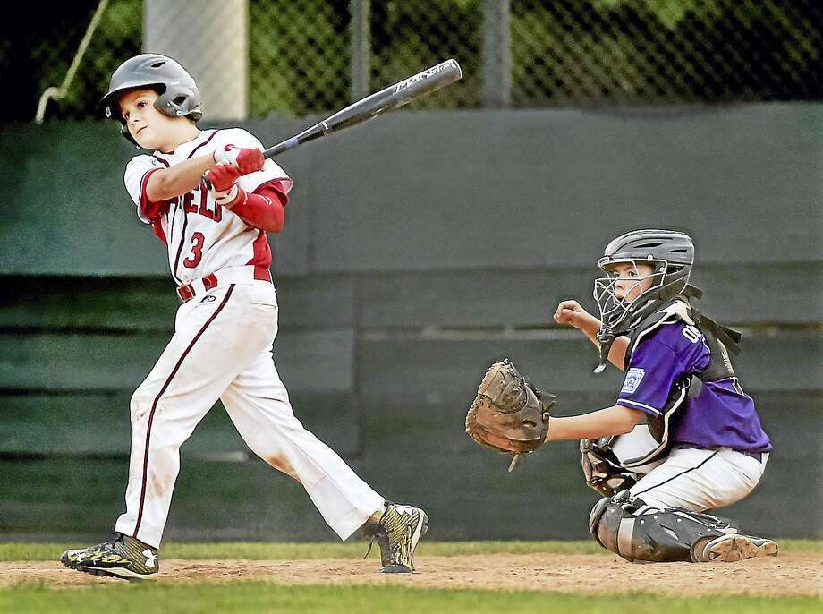 North Branford catcher John Onofrio watches the ball sail over the fence as Fairfield American's Aidan Rivera hits a grand slam in the fifth inning on Friday. Photo: Catherine Avalone/Hearst Connecticut Media   / Catherine Avalone/New Haven Register