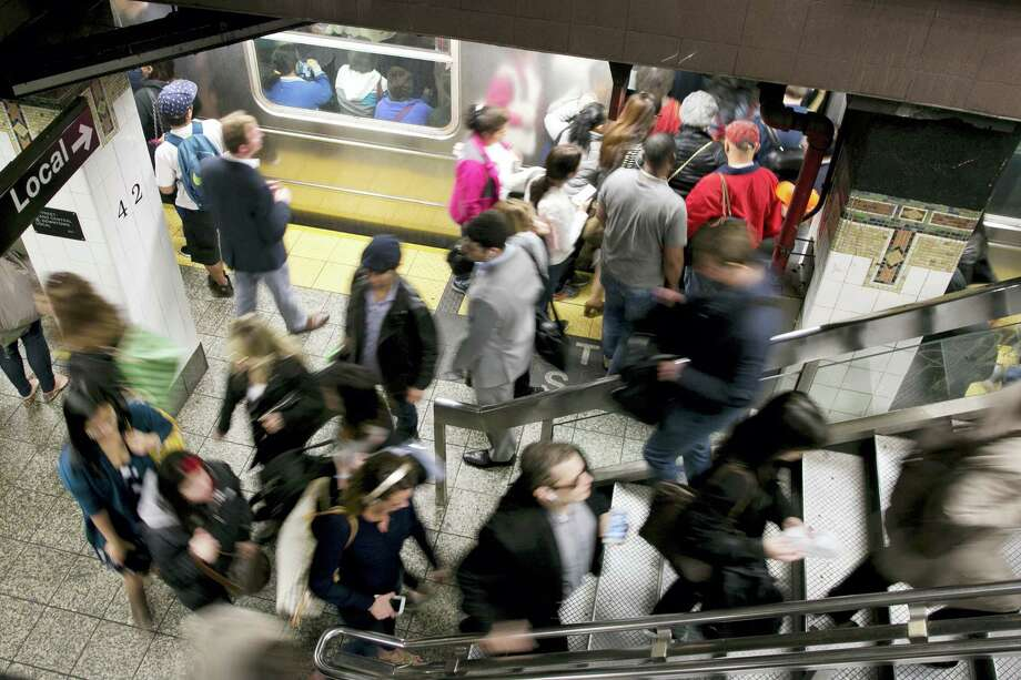 Commuters stream on and off a subway in the Grand Central station, Thursday, May 12, 2016, in New York. Photo: Mark Lennihan / AP Photo   / Copyright 2017 The Associated Press. All rights reserved.