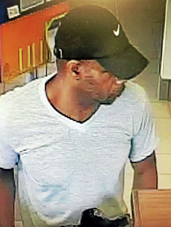 Police are looking for the public's help to identify a person connected with a bank robbery in Orange Monday. Photo: Courtesy Of Orange Police Department