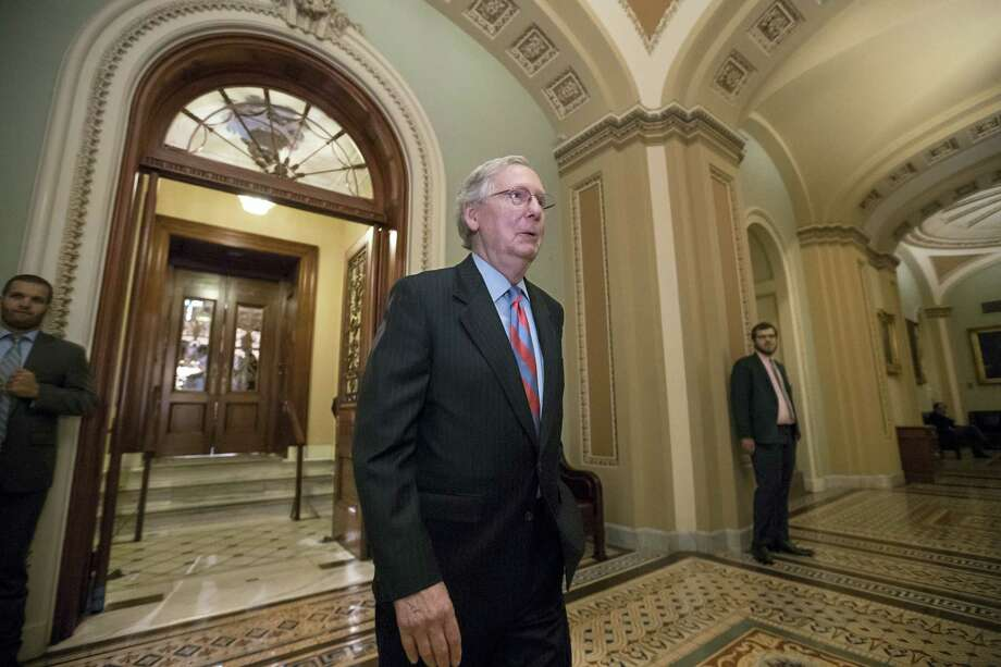 """Senate Majority Leader Mitch McConnell of Ky. leaves the Senate chamber on Capitol Hill in Washington, Thursday after a vote as the Republican majority in Congress remains stymied by their inability to fulfill their political promise to repeal and replace """"Obamacare"""" because of opposition and wavering within the GOP ranks. Photo: J. Scott Applewhite — The Associated Press   / Copyright 2017 The Associated Press. All rights reserved."""