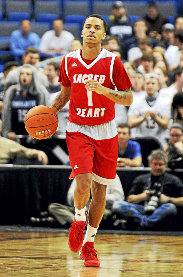Sacred Heart's Cane Broome (1) dribbles during Connecticut's 82-49 victory over Sacred Heart in an NCAA college basketball game in Hartford, Conn., on Wednesday, Dec. 2, 2015. (AP Photo/Fred Beckham) Photo: AP / FR153656 AP