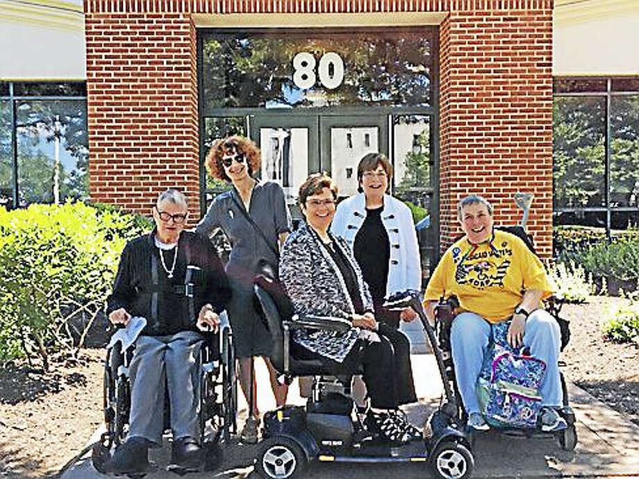 """The Capitol Five"": Gary Gross, Elanah Sherman, Melissa Marshall, Molly Cole, and Elaine Kolb line up outside Community Court. Photo: Christine Stuart / Ctnewsjunkie"