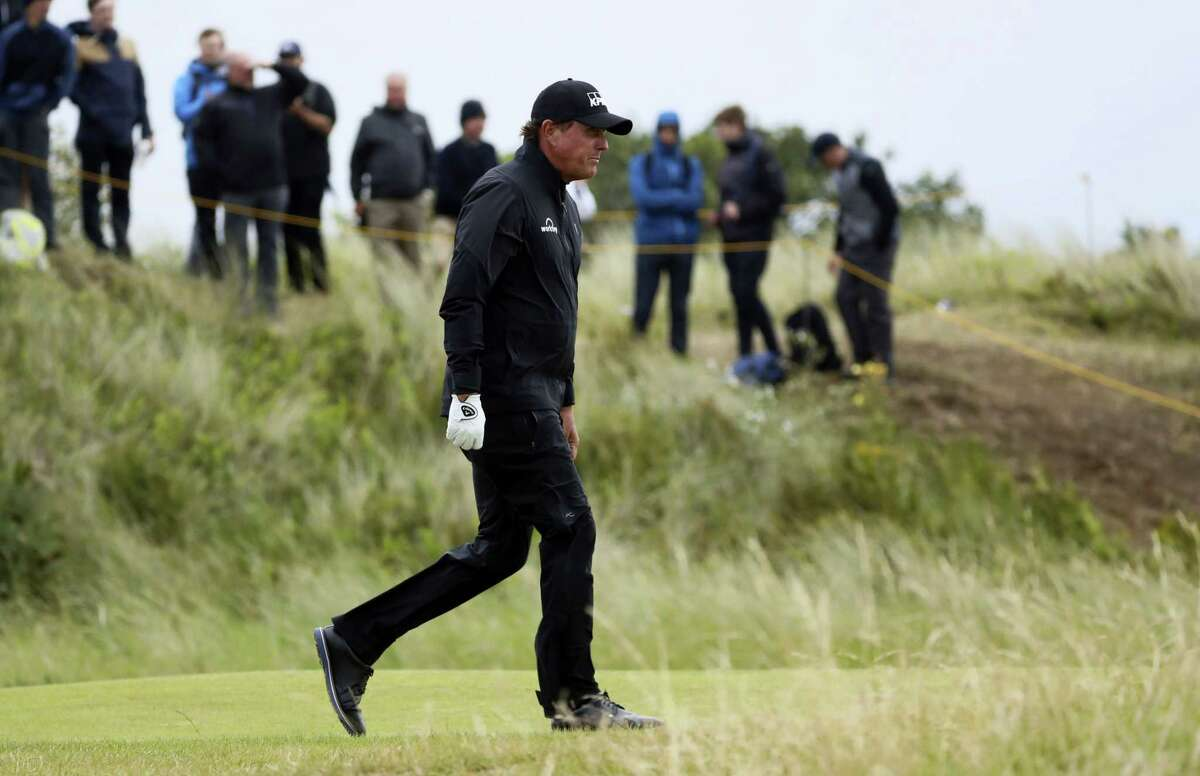 Phil Mickelson walks along the 10th fairway during the second round of the British Open.