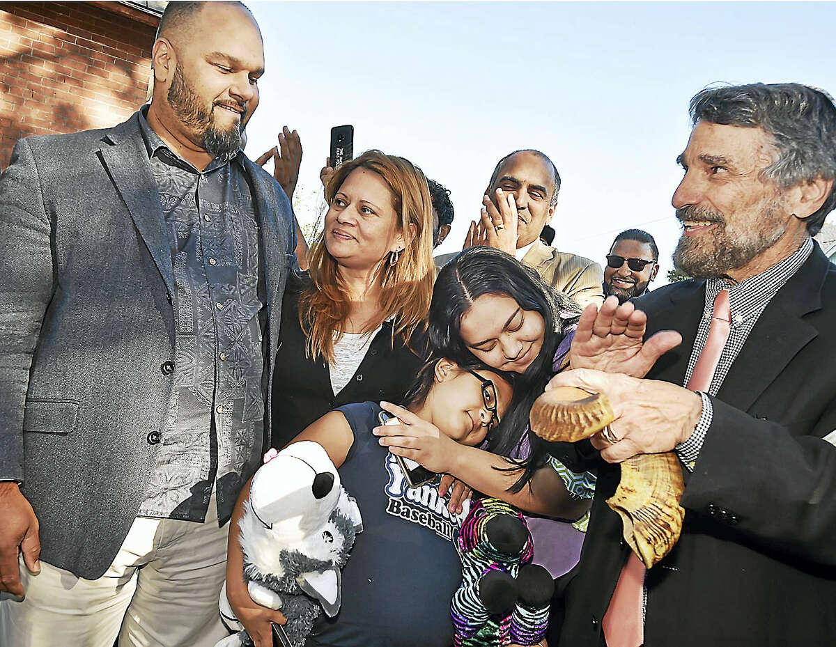 From left, the Rev. Hector Otero; Nury Chavarria; her two daughters Lindsay and Hayley; and Rabbi Herbert Brockman at a press conference Wednesday in New Haven.