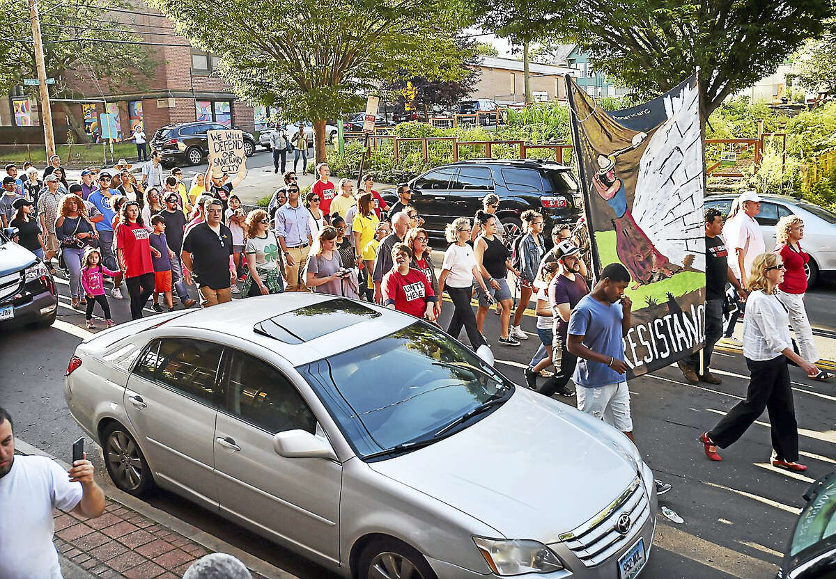 Hundreds of supporters march down Grand Avenue behind Nury Chavarria Wednesday in New Haven.