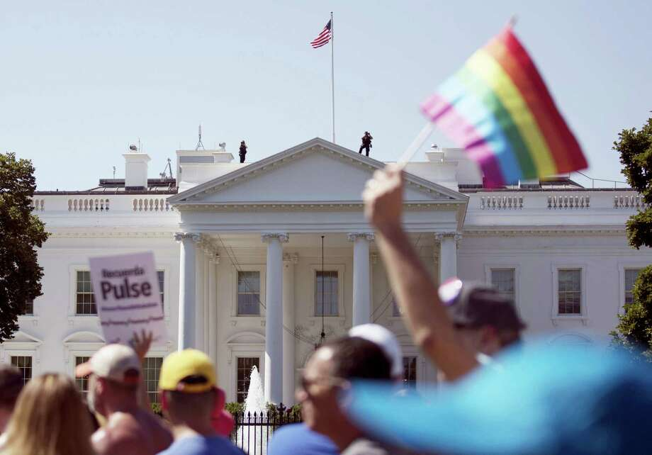 In this Sunday, June 11, 2017 file photo, Equality March for Unity and Pride participants march past the White House in Washington. Most LGBT-rights activists never believed Donald Trump's campaign promises to be their friend. With his move to ban transgender people from military service on Wednesday, July 26, 2017, on top of other actions and appointments, they now see him as openly hostile. Photo: Carolyn Kaster / AP Photo   / Copyright 2017 The Associated Press. All rights reserved.
