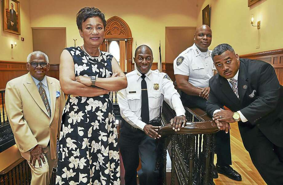 Mayor Toni Harp, Interim Superintendent of Schools Reginald Mayo, Police Chief Anthony Campbell, Yale University Police Department Chief Ronnell A. Higgins and Michael Briscoe, director of Public Safety, at New Haven City Hall Tuesday at 165 Church St. Photo: Catherine Avalone / Hearst Connecticut Media   / Catherine Avalone/New Haven Register