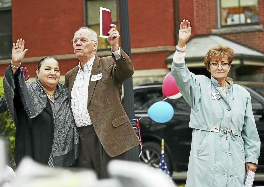The Rev. John Hinson, pastor of First Baptist Church, his wife, Maude, left, and Pat Boemmels pray at the 66th National Day of Prayer in Ansonia at Veterans Memorial Park. Photo: File Photo   / Catherine Avalone/New Haven Register