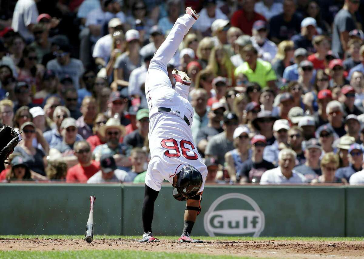 Eduardo Nunez stands on his hands after being hit by a pitch in the third inning.