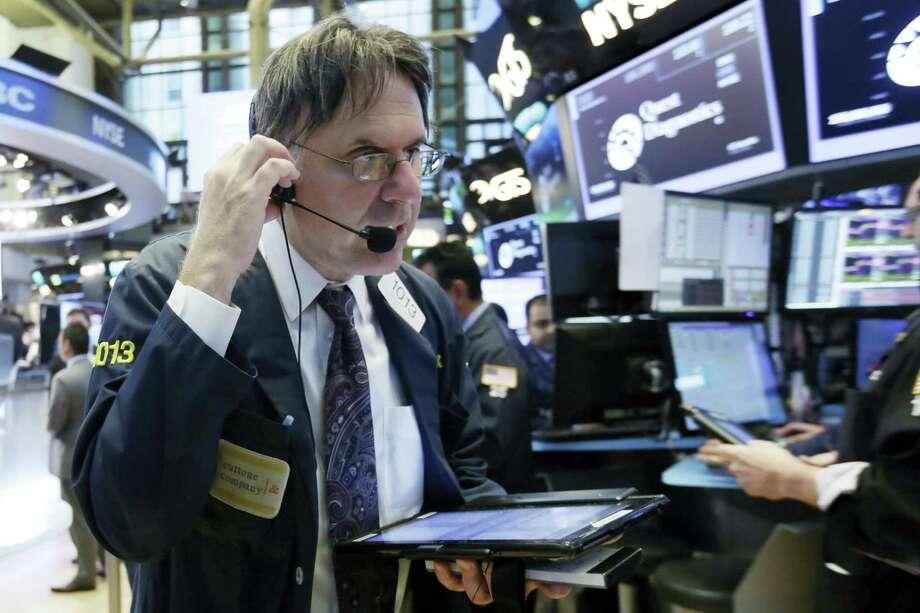 Trader Joseph Chirico works on the floor of the New York Stock Exchange Wednesday. Photo: Richard Drew / The Associated Press   / AP