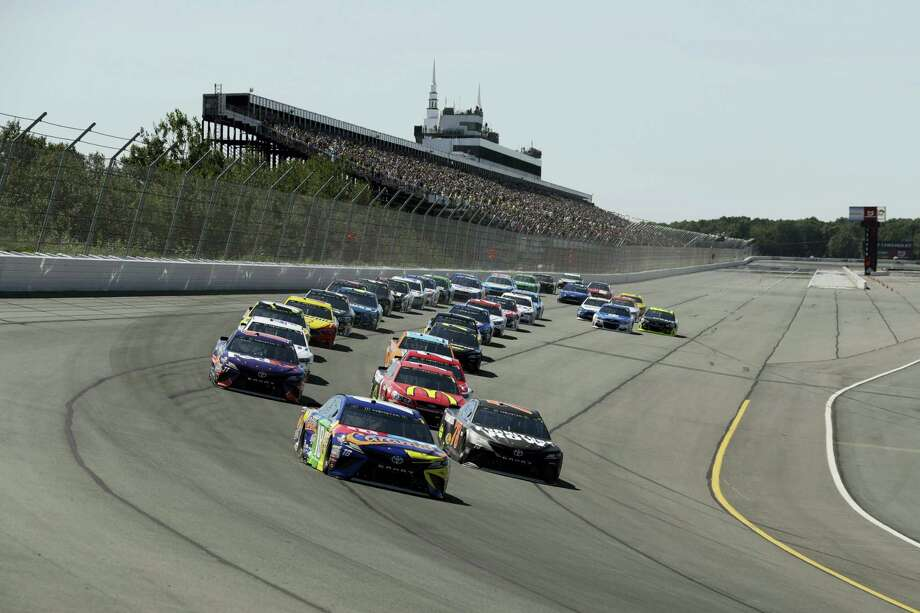 Kyle Busch leads the pack during Sunday's race at Pocono Raceway. Photo: Matt Slocum — The Associated Press   / Copyright 2017 The Associated Press. All rights reserved.