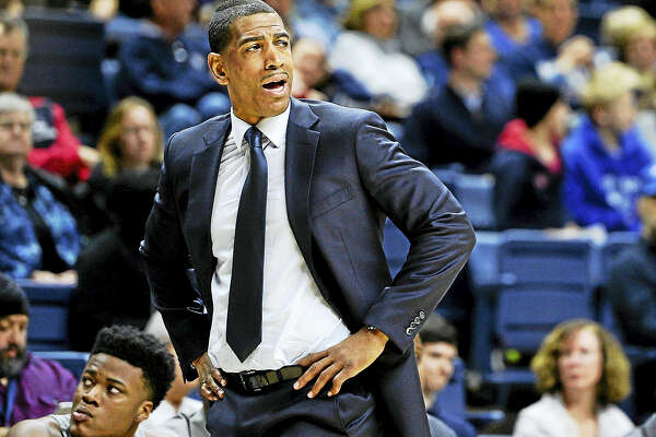 UConn men's basketball coach Kevin Ollie reacts during the first half of the team's game against South Florida last February.