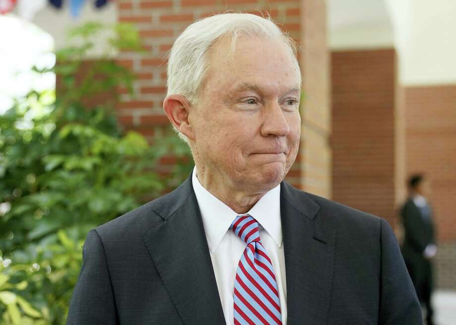 U.S. Attorney General Jeff Sessions starts to walk away after an interview with The Associated Press at the U.S. Embassy in San Salvador, El Salvador, Thursday, July 27, 2017. Sessions is forging ahead with a tough-on-crime agenda that once endeared him to President Trump, who has since taken to berating him. Sessions is in El Salvador to step up international cooperation against the violent street gang MS-13. Photo: Pablo Martinez Monsivais / AP Photo   / Copyright 2017 The Associated Press. All rights reserved.