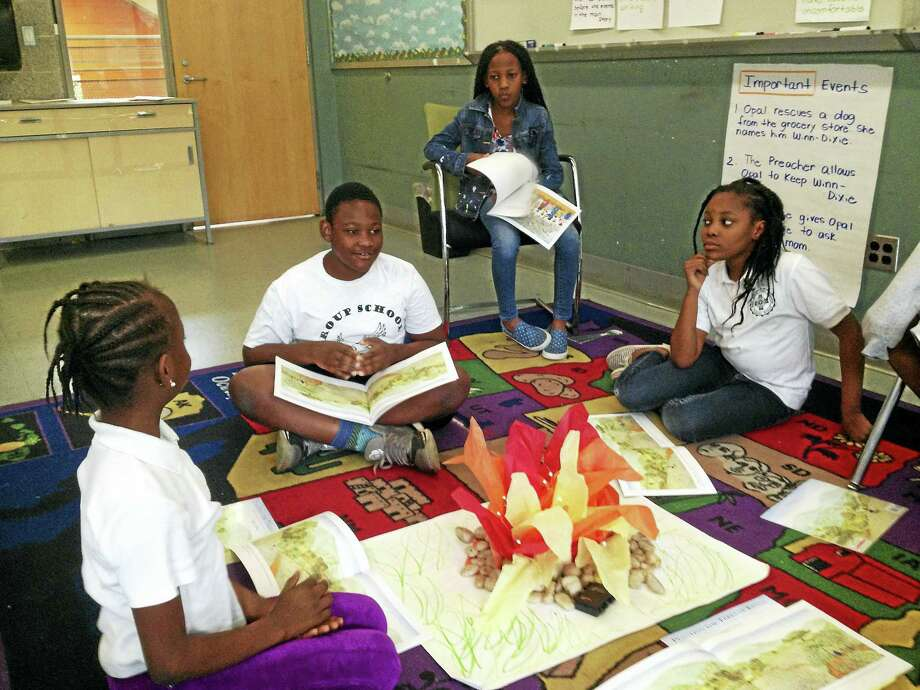 "Students in the New Haven Public Schools reading summer school program at King/Robinson participate in ""bunk time."" From left, Austina Nyonee, 10; Janii Morgan, 10; Adam Compton, 10; and Orokwu Igoamadi, 9. Photo: Brian Zahn / HEARST CONNECTICUT Media"