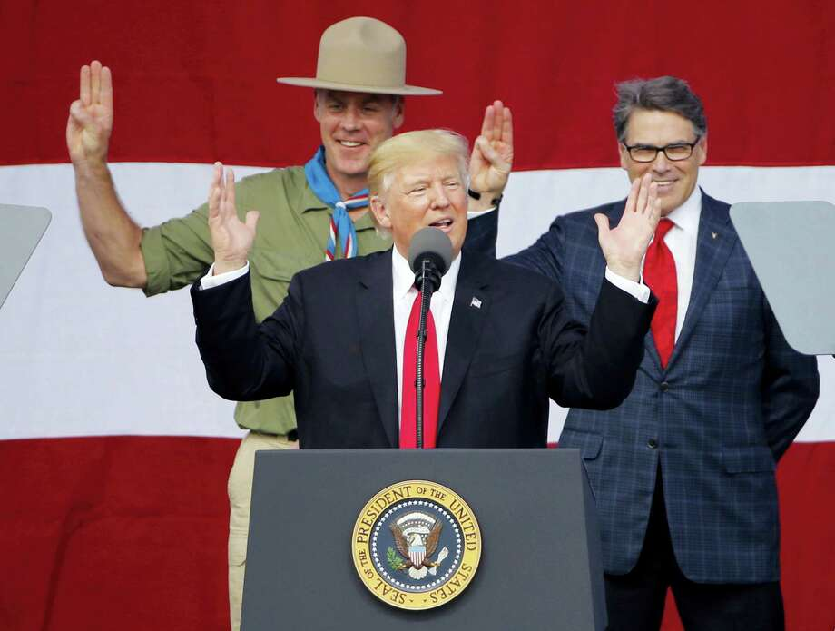 President DonaldTrump, front left, gestures as former boys scouts, Interior Secretary Ryan Zinke, left, Energy Secretary Rick Perry, watch at the 2017 National Boy Scout Jamboree at the Summit in Glen Jean,W. Va., Monday, July 24, 2017. Photo: AP Photo/Steve Helber    / Copyright 2017 The Associated Press. All rights reserved.