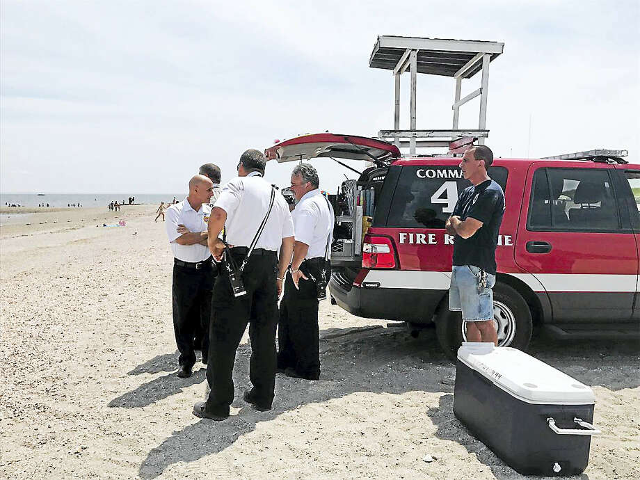 Two people were swept off a sandbar into Long Island Sound Friday. Photo: Jess Lerner / Hearst Connecticut Media