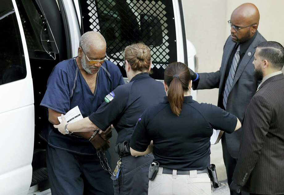 James Mathew Bradley Jr., 60, of Clearwater, Florida, left, arrives at the federal courthouse for a hearing on July 24, 2017 in San Antonio. Bradley was arrested in connection with the deaths of multiple people packed into a broiling tractor-trailer. Photo: AP Photo – Eric Gay   / Copyright 2017 The Associated Press. All rights reserved.