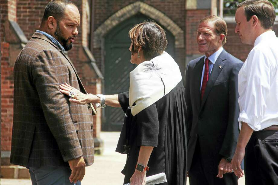 From left, Pastor Hector Otero of Iglesia de Dios Pentecostal speaks to U.S. Rep. Rosa DeLauro and U.S. Sens. Richard Blumenthal and Chris Murphy Friday in New Haven. Photo: Esteban L. Hernandez / Hearst Connecticut Media