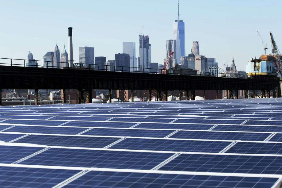 MARK LENNIHAN / THE ASSOCIATED PRESS   A rooftop is covered with solar panels at the Brooklyn Navy Yard in New York. Photo: AP / Copyright 2017 The Associated Press. All rights reserved.