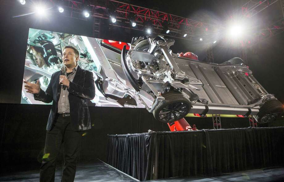"RINGO H.W. CHIU / THE ASSOCIATED PRESS   Elon Musk, CEO of Tesla Motors Inc., announces its new car Tesla ""D"" in Hawthorne, Calif. Photo: AP / FR170512 AP"