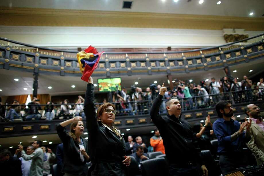 "Anti-government lawmakers shout ""Fraud,"" during a session of Venezuela's National Assembly, in Caracas, Venezuela, Wednesday, Aug. 2, 2017. The National assembly's claim of a fraudulent elections was bolstered when the CEO of the voting technology company Smartmatic said Wednesday that results of Venezuela's election for the all-powerful constituent assembly were off by at least 1 million votes. (AP Photo/Ariana Cubillos) Photo: Ariana Cubillos, STF / Copyright 2017 The Associated Press. All rights reserved."