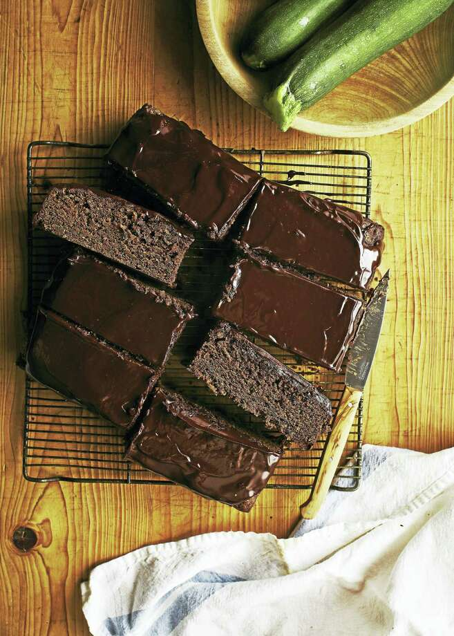 """Chocolate sour cream zucchini cake with chocolate glaze. Photo: Johnny Autry / Excerpted From """"The Harvest Baker,"""" Used With Permission From Storey Publishing"""