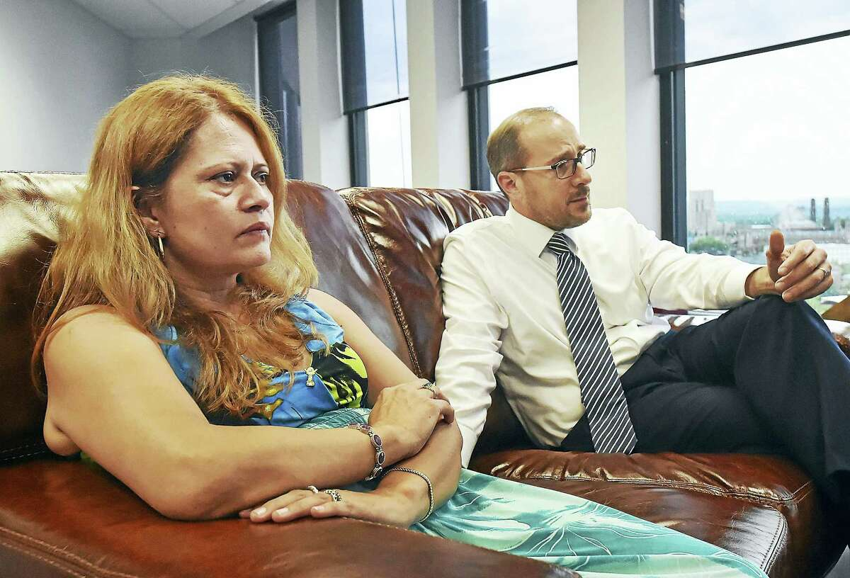 Nury Chavarria and her attorney Glenn Formica at his office at 195 Church St. in New Haven.