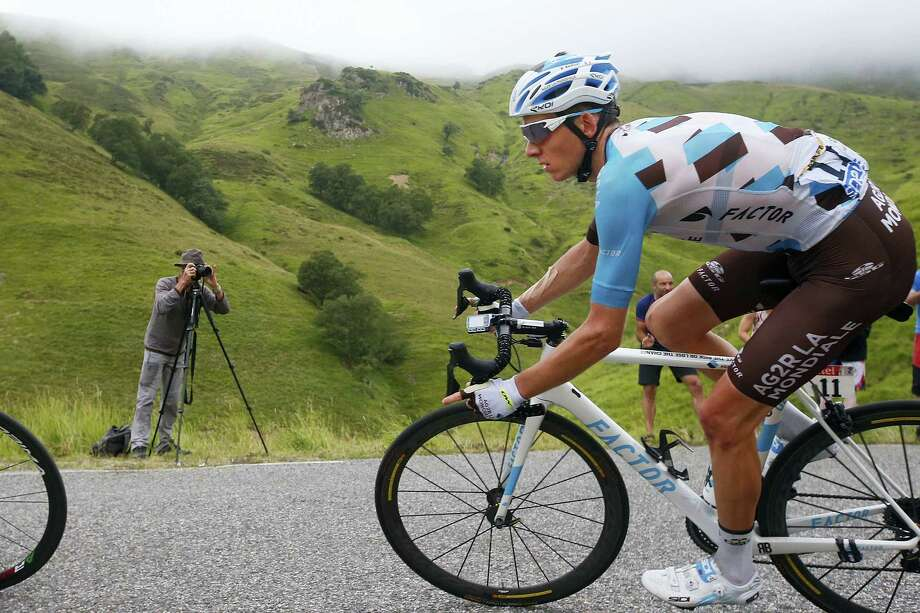 Stage winner France's Romain Bardet speeds downhill during the twelfth stage of the Tour de France cycling race over 214.5 kilometers (133.3 miles) with start in Pau and finish in Peyragudes, France on July 13, 2017. Photo: AP Photo — Peter Dejong   / Copyright 2017 The Associated Press. All rights reserved.